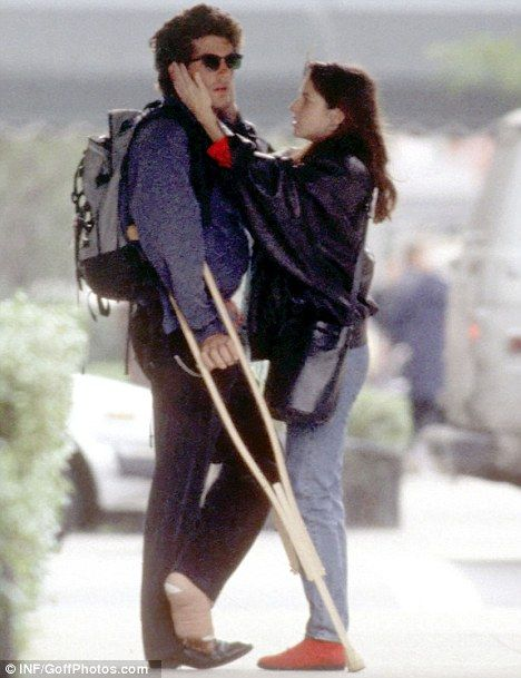 Young love: John F Kennedy Jr pictured with then-girlfriend Christina Haag in 1988, after he tore ligaments in his ankle. The couple dated for five years