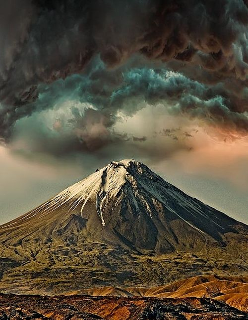 "Mount Ararat (Արարատ), Turkey is a snow-capped, dormant volcanic cone.  It has two peaks: Greater Ararat (the highest peak with an elevation of 5,137 m) and Lesser Ararat (with an elevation of 3,896 m). Mount Ararat in Judeo-Christian tradition is associated with the ""Mountains of Ararat"" where, according to the book of Genesis, Noah's ark came to rest.  by Sako Tchilingirian"