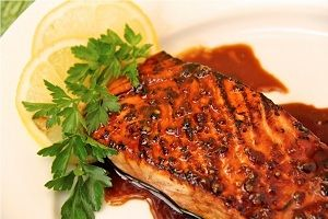Salmon fish which is baked in foil and brushed with the honey and sesame oil mixture is known as Baked Honey & Sesame Salmon.Check out here:http://goo.gl/fcJioT