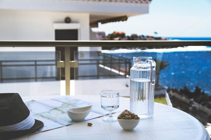 Ocean view from a balcony.  by kawizen  on @creativemarketmap,#holidays,#sun,#sunny,#traveler, #travelling,#globetrotter,#planning,#water, #glass,#pistachios,#snacks,#ocean,#oceanview,#marine,#sunhat,#hat,#hot,#balcony, #terrace,#sea,#day,#light, #spain,#canaryisland,#tenerife,#island,#temperature, #warm,#hightemperature,#relax,#chillout, #trip,#journey