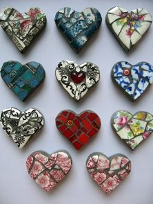 These heart mosaics are made from glass pieces of old plates. They are very interesting and can be placed in gardens to decorate them up and add some color.