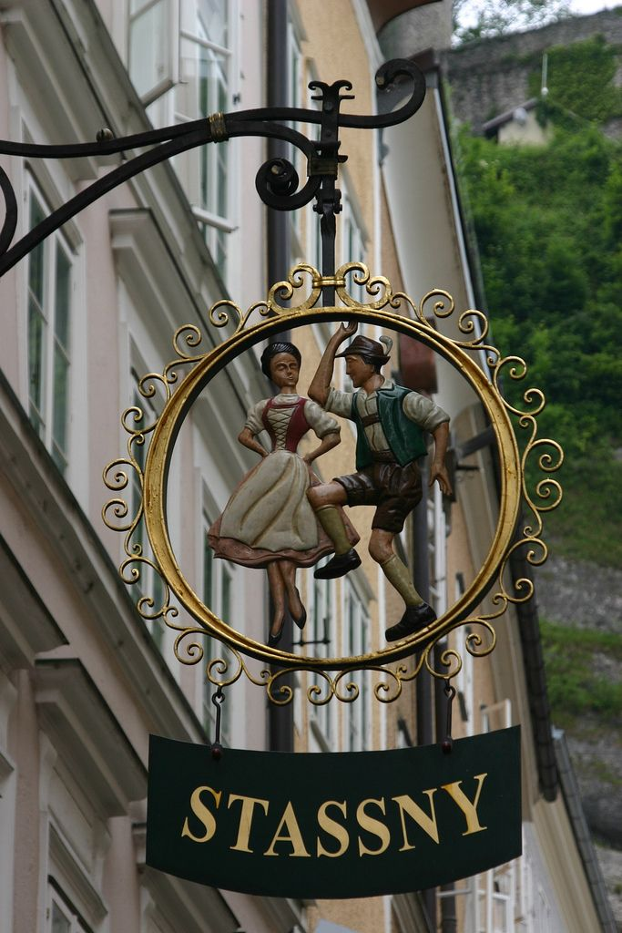 """Street sign in Salzburgs famous shopping street"" by Raphael Bick on Flickr - Wrought Iron Street sign on Salzburg's famous shopping street...Salzburg, Austria"