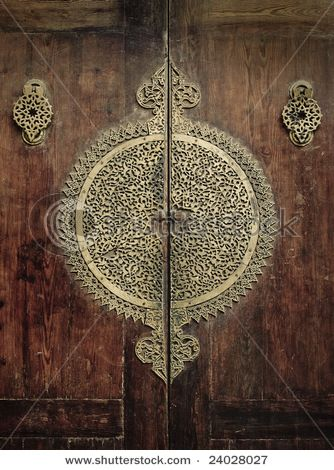 Fabulous ancient doors in Africa. (trying to pretend I don't see shutterstock across the doors.)