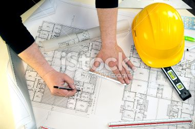 man drawing the project of a house Royalty Free Stock Photo