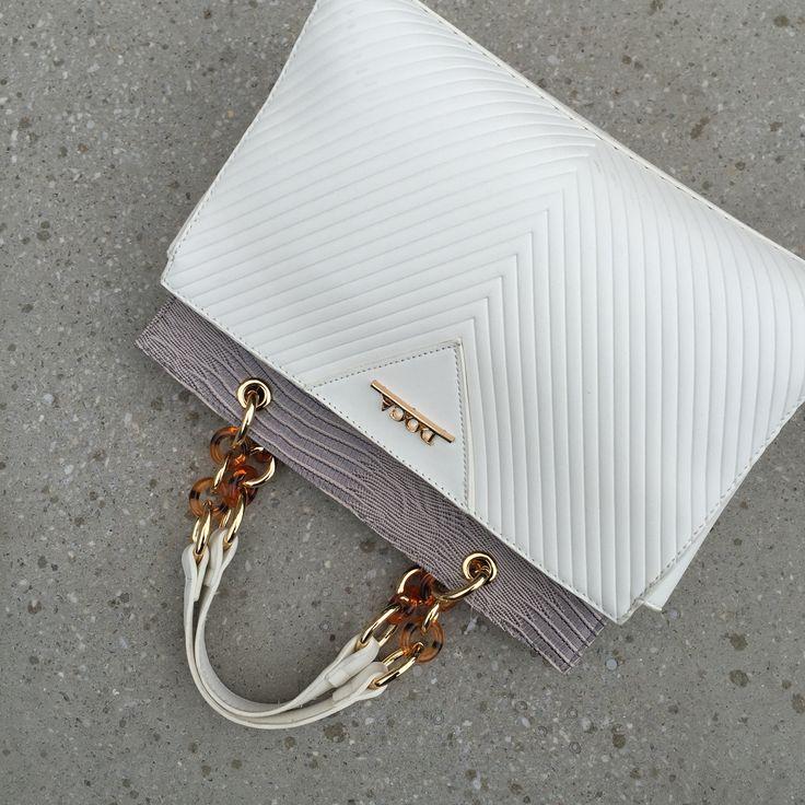 Your white classy handbag  DOCA