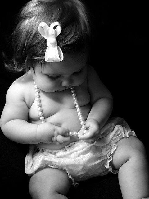 Sort of looked like this, but baby was holding/looking at Christmas ball ornament..with Christmas lights (lit up) all around her.  Toooo precious!!