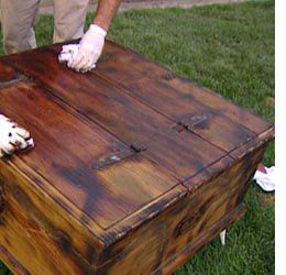 Home-Dzine - age or distress unfinished pine furniture with woodoc - 1) Bang on and scratch up your wood with various tools, 2) Sand edges smooth so it looks worn, 3) Lightly and slowly torch edges, 4) Apply stain with brush and immediately rag off.