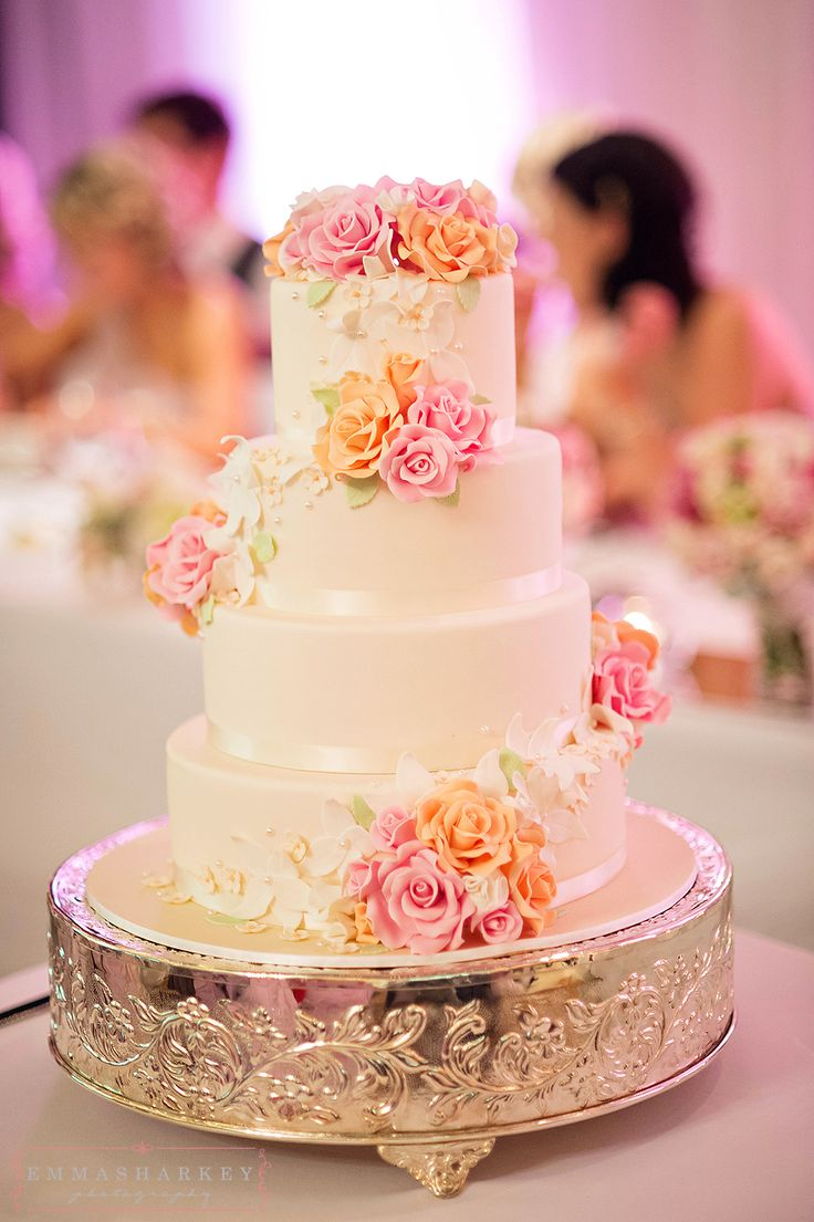 Emma Sharkey Adelaide Wedding Photographer  This amazing four tiered wedding cake features ivory fondant icing and then hand made pink, apricot and cream flowers. It's just decadent and out of this world!  Wedding cake inspiration, wedding photography, national wine centre