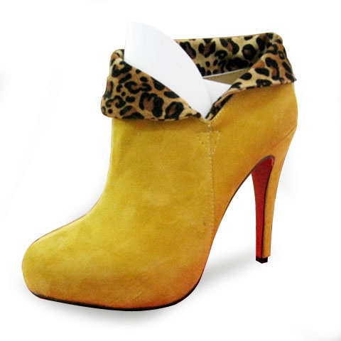 Christian Louboutin Suede Ankle BootsAppealing suede bootie with  button-and-loop closure. Leg