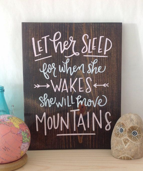 Let her sleep for when she wakes she will move mountains. This 9x12 wood sign is hand sanded, stained and then hand painted with a handlettered motivational quote. A sawtooth hanger on back makes this wall decor ready to hang! This is a beautiful piece that is perfect for a nursery or little girls room. We cant wait to see it hanging in its new home!  Every sign is made with real wood and each piece of wood is unique. We take great care to pick beautiful wood and love the character that the…