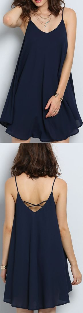 Loose sexy shift dress with Spaghetti Strap front and cross collar back.Navy�