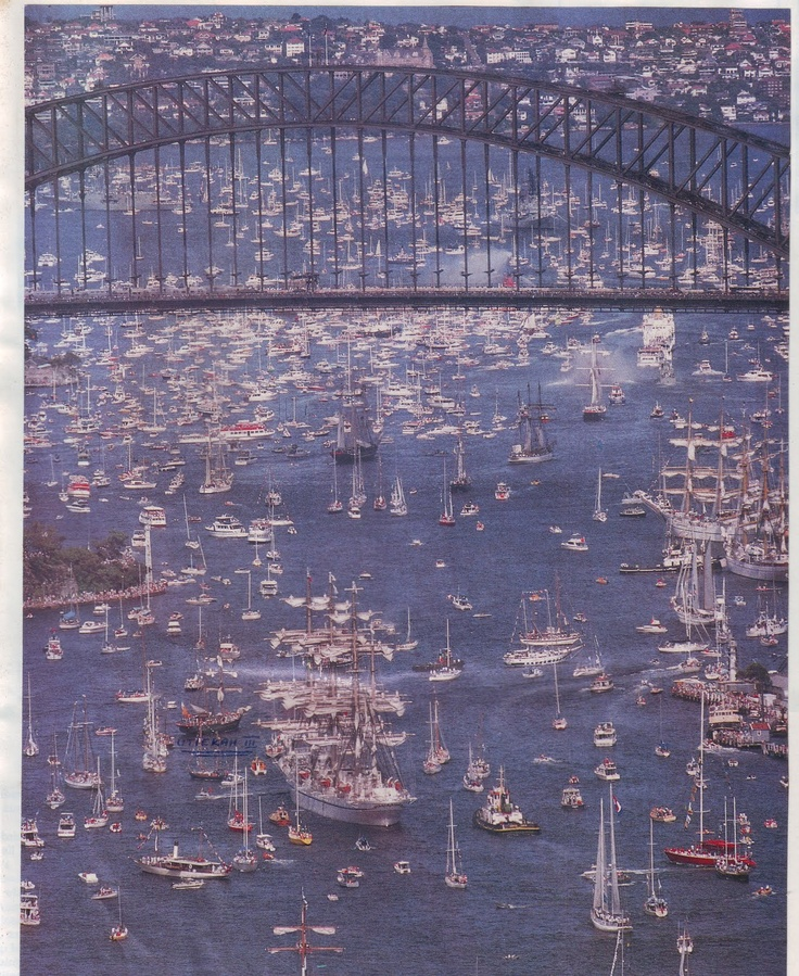 The tall ships, surrounded by a flotilla of crafts, in Sydney Harbour, New South Wales. Australia.