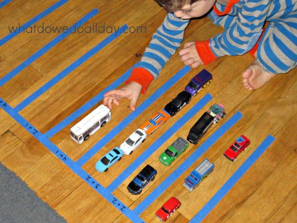 Parking lot addition is a fun math activity that uses toy cars and is perfect for Kindergarteners and kids working on their basic math skills.