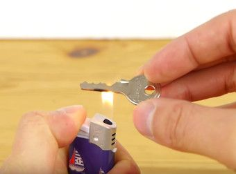 Here's How To Make A Perfect Key Copy With A Tin Can, A Lighter, And Scissors