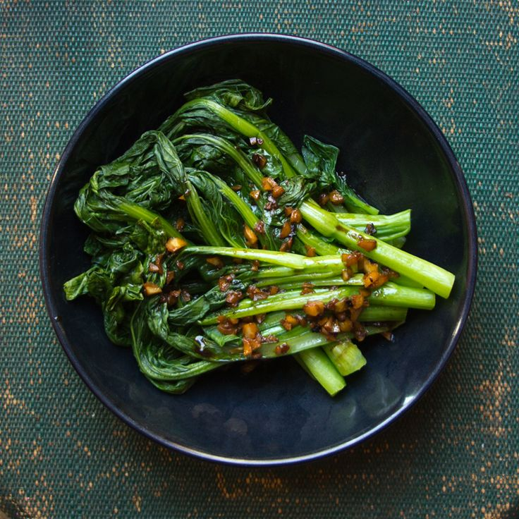 Choy sum is topped with a flavorful mixture of peanut oil, soy sauce, and garlic for a bright and quick side dish.