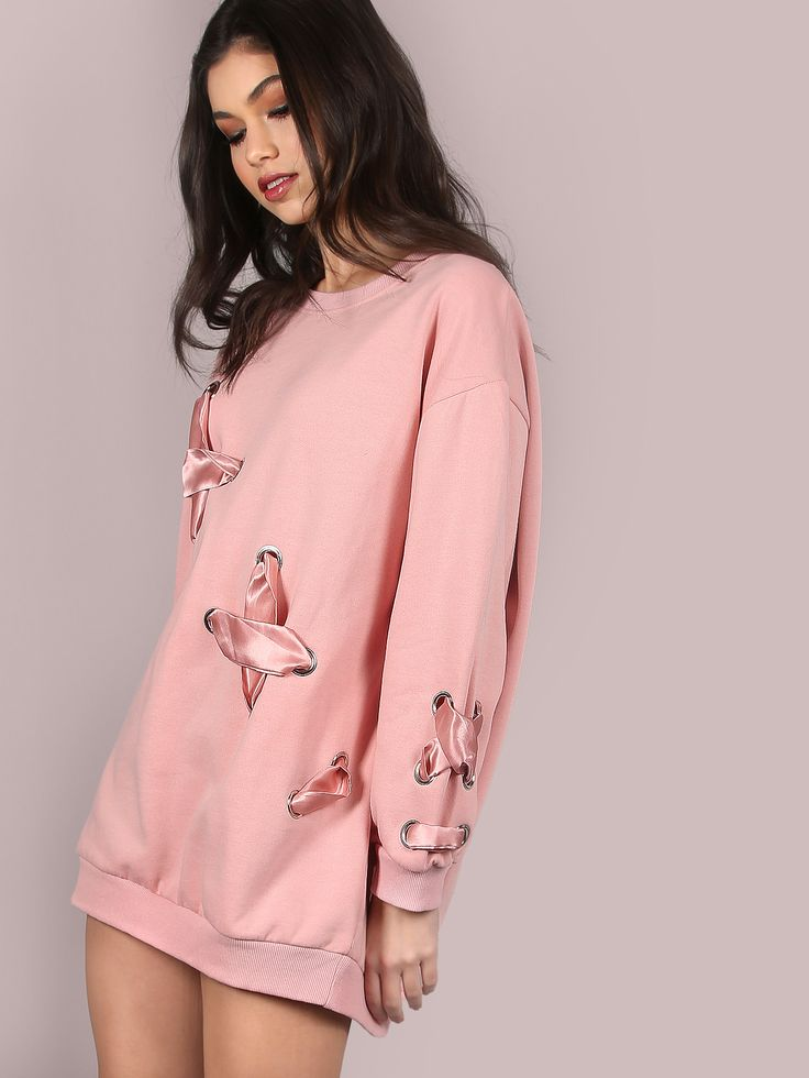 """Look casually adorable in this dainty number. Featuring an oversize pullover with a crew neckline, thick ribbon laces that are weaved through eyelets across the body +sleeve of the garmentand an adorable pink hue. Pullover measures 29"""" in. from top to bottom hem. Throw on light washed skinny ankle grazers and tennis shoes. Model is pictured in a size S. #pastel #MakeMeChic #style #fashion #newarrivals #winter16"""