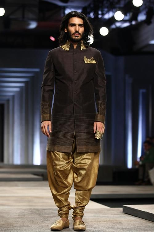 A model walks the ramp for designers Shantanu and Nikhil on Day 1 of India Bridal Fashion Week, held in New Delhi, on July 23, 2013. (Pic: Viral Bhayani)