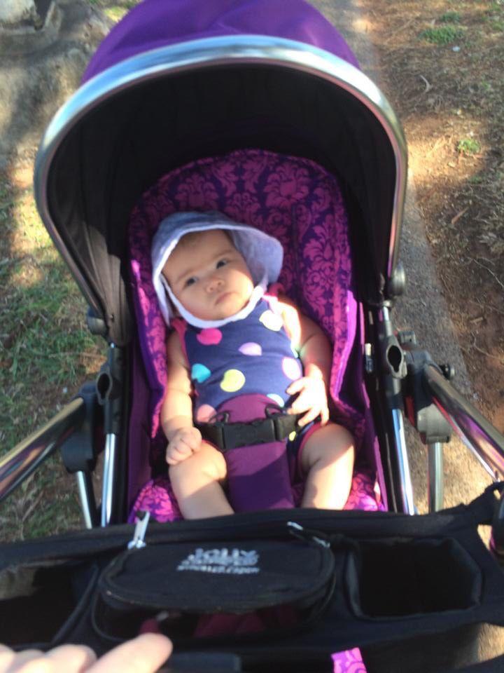 Beautiful baby with purple damask Bambella Designs pram liner