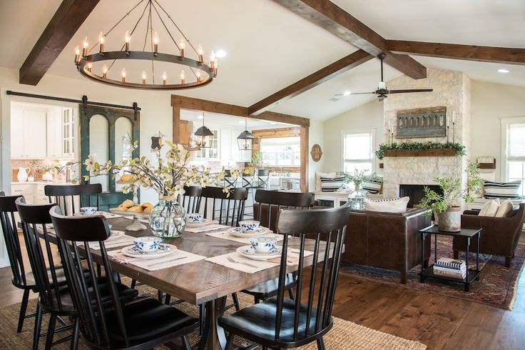 The pitch of the roof was already high, so it made adding beams to this space simple, while adding a grander feel to this main living and dining room area.