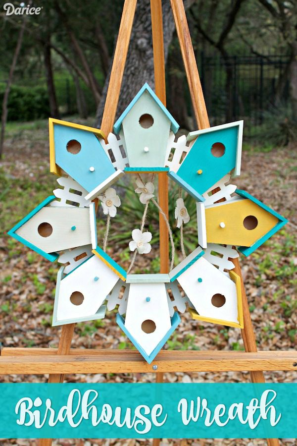 Are you on the lookout for DIY birdhouse ideas to incorporate into your decor this spring? You'll love this idea for a wreath made out painted birdhouses.