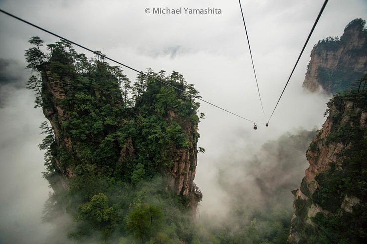 Photograph by Michael Yamashita. @yamashitaphoto: The otherworldly cliffs of China's Zhangjiajie National Forest Park were the real world inspiration for the floating Hallelujah Mountains of Pandora in James Cameron's film 'Avatar'. These sandstone pillars rise up to 500 meters averaging 300 to 400 meters and numbering in the thousands. Pictured here is the Tianzishan cable car.  #Wulingyuan #Zhangjiajie #mountains #China #Avatar @natgeocreative @thephotosociety by natgeo