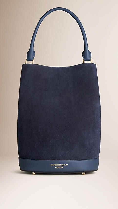 Burberry Navy The Bucket Bag in Suede - The Bucket Bag in English suede. Inspired by the runway, the design is made in Italy with hand-finished details. A detachable matching wristlet features inside. Discover the women's bags collection at Burberry.com