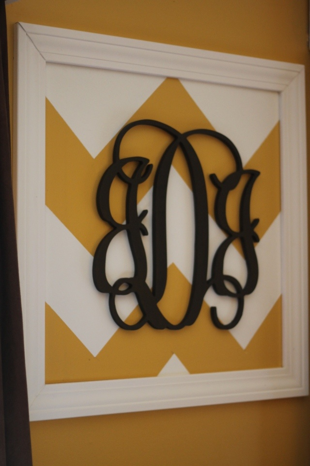 DIY Chevron monogram wall art - I love the use of the wall color in this, because it makes the chevron design less busy looking on the wall.