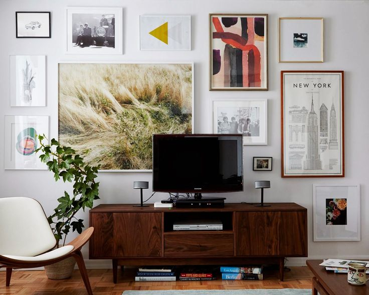 Ugh. A framed art cluster -- but I like it and need ideas for a massive wall behind my TV. I like that the large piece isn't centered above the TV.