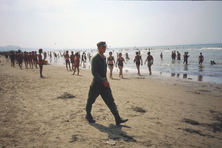 A soldier of the Albanian People's Army walking past a beach on the Adriatic Sea coast in Albania, 1984.