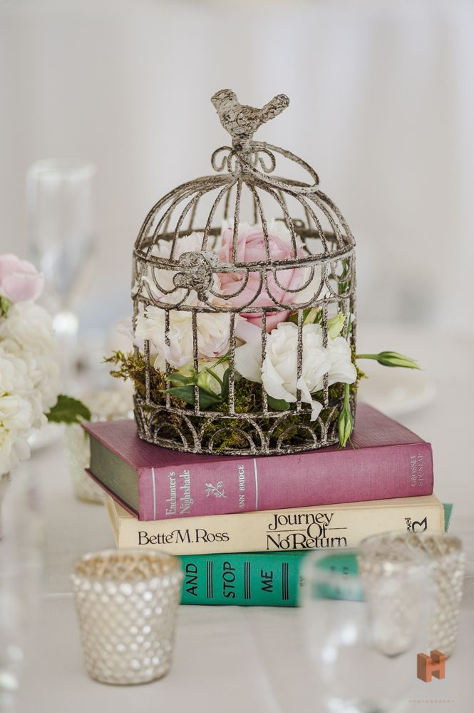 flowers in birdcage on books wedding center piece for vinatge weddings - Deer Pearl Flowers