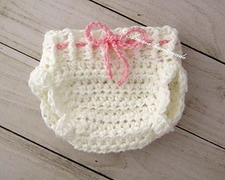 This is a PDF crochet pattern for a baby girl diaper cover.