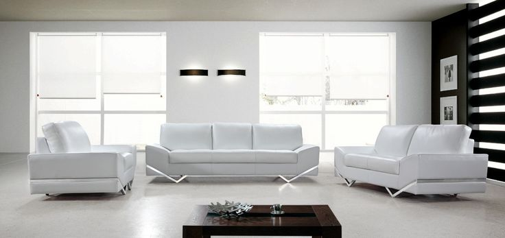 Divani Casa Vanity - White Modern Sofa Set. The Vanity white half leather contemporary sofa set is comprised of a sofa, a loveseat, and chair.  The clearly immaculate upholstery provides a clean and neutral tone.  This harmonious array of pieces will give a special quality to any room.  The stainless steel angular legs wrap around the sides of each member of the set creating a distinctly abstract appearance, while the tufted seat cushions keep them grounded in tradition. Dimensions: Sofa:...