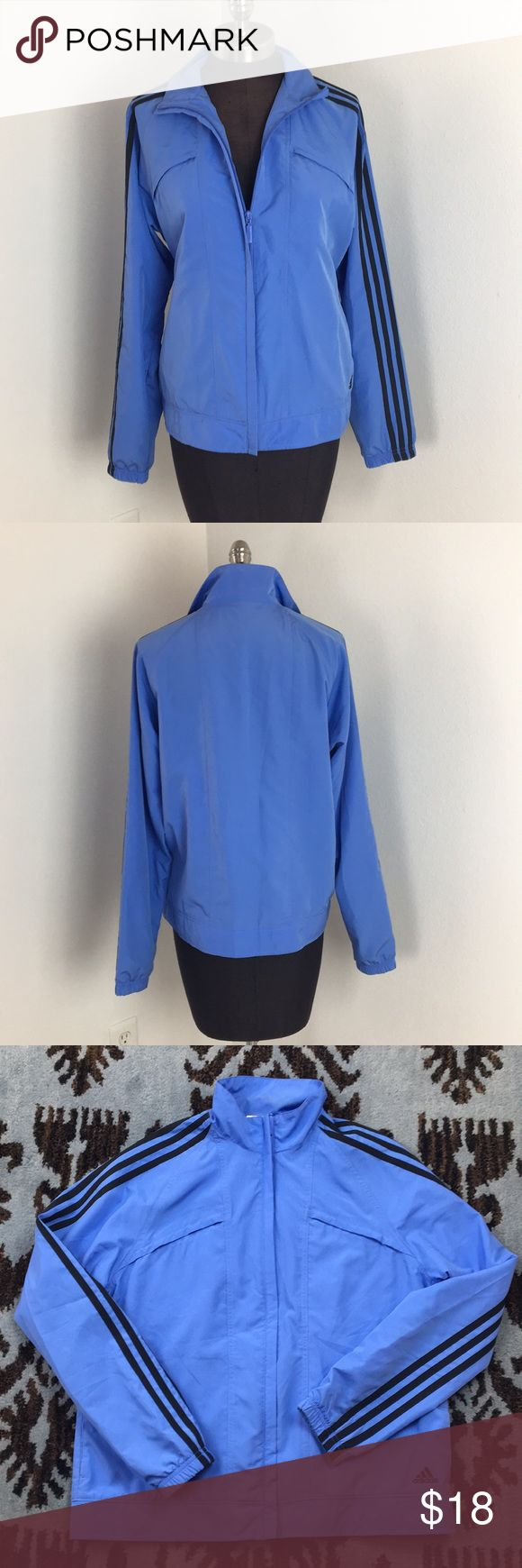"""Adidas Blue Striped Windbreaker Adidas Blue with Navy striped windbreaker, ladies size large. Two pockets on chest. Mesh lined. 100% polyester. Excellent condition, no signs of wear. One hidden zip pocket near hem. Full length zip. True to size. 26"""" long. Chest measures 21"""" flat. adidas Jackets & Coats"""