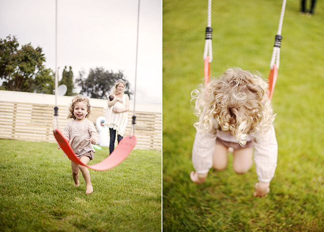 Here's Isla running for a turn on her backyard swing set.  Her Mum Katie holds her baby sister Avyn in the background.