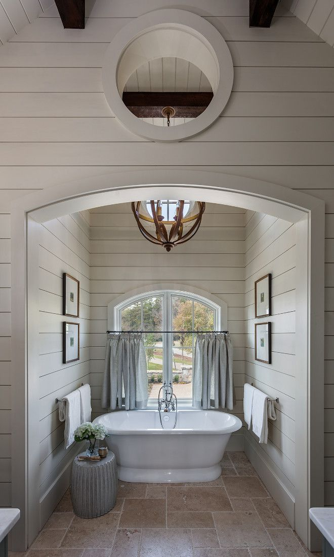 Shiplap Bathroom Nook. Shiplap Bath Nook. Arch Bath nook with shiplap paneling, arched window, exposed beams, orb pendant light and framed art #Arch #bathnook #bathroom #bathroomnook #shiplap #shiplappaneling #archedwindow #exposedbeams #orbpendant #lighting #framedart Wright Design