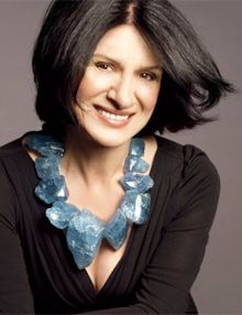 Paloma Picasso wearing a large gemstone necklace. Her work is often on display at Tiffany's in NYC.