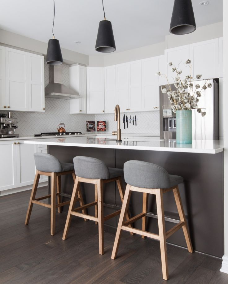 kitchen / dining room - love the herringbone subway tile, cohesive pallette of black, white, brass, gray, and wood tones