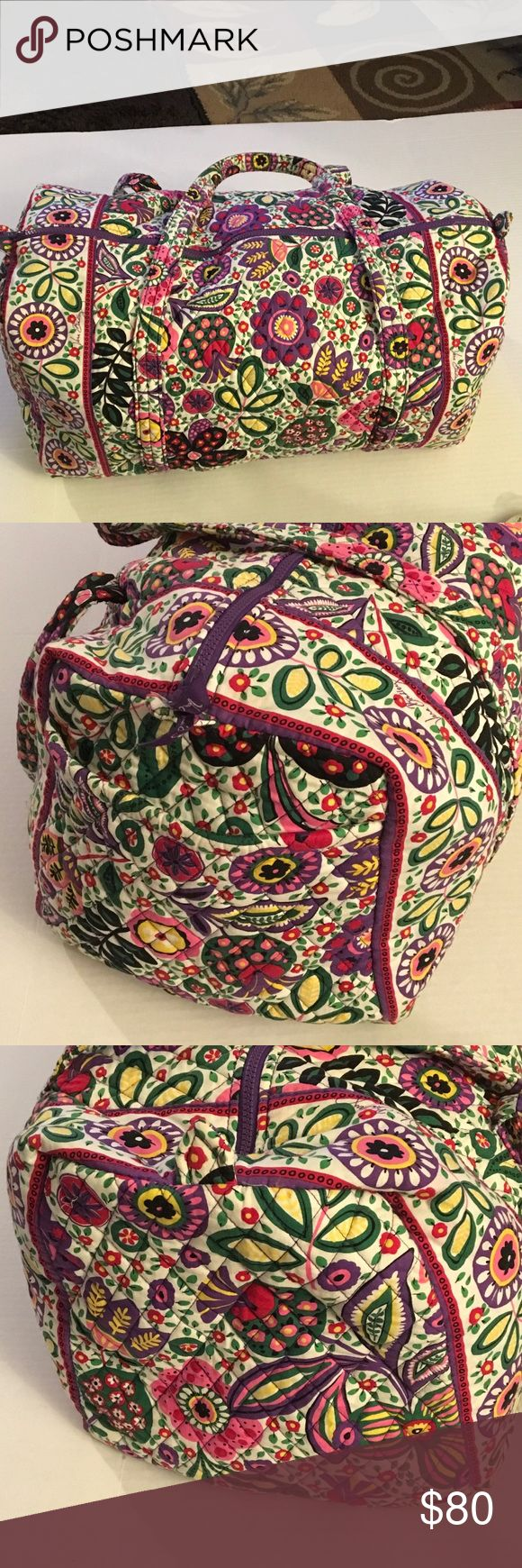"Vera Bradley duffel bag Like new Vera Bradley floral duffel bag.  Two top handles.  Top zipper.  Purple trim.  Interior is also floral.  Like new.  Not dirty.  Clean inside and out.  Approx size 23"" wide and stands about 15.  11"" deep.  Handles drop about 17"". Vera Bradley Bags Travel Bags"