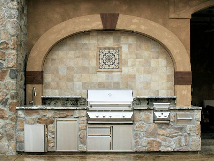 The Ultimate Outdoor Kitchen. Concept by Alan Neighbors, Art of the Earth, Designed by Terry Sims, The Garden Artist, LLC and Constructed by Patrick McIntire Construction.