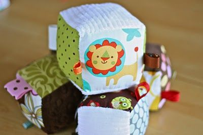 Baby block tutorial. Read somewhere to use a charm pack. Brilliant!! ... add jingle bells or store bags to make noise.