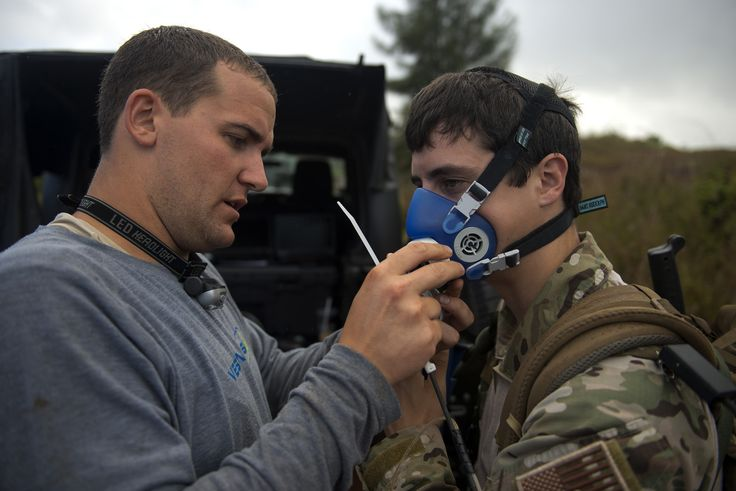 University of Pittsburgh researcher Andrew Simonson attaches a maximal oxygen consumption mask to Senior Airman Brian Huhtala. Researchers measure the VO2 Max of Airmen while they conduct training missions in order to gather data in an operational environment. Huhtala is a combat controller assigned to the 22nd Special Tactics Squadron at Joint Base Lewis-McChord, Wash. (U.S. Air Force photo/Master Sgt. Jeffrey Allen)