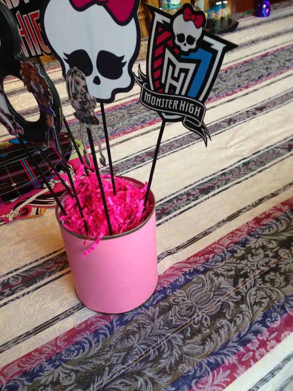 Monster High Birthday Centerpiece This Monster High centerpieces will add the extra touch to your party. This listing is for a 7 stick centerpiece sticks as shown in the picture. Made with quality card stock and assembled with glue. The centerpiece comes complete with... Wooden