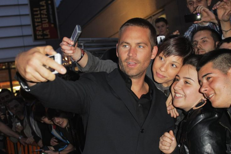 He snapped photos with a group of fans during the Fast Five premiere in Rome, Italy, in April 2011.