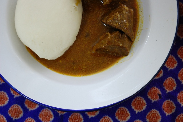 """pounded yam an african dish Pounded yam is smooth dough of mashed yam frequently eaten with a vegetable soup or fret it is sometimes called """"iyan""""  it is much like mashed murphies but smoother heavier and tastier."""