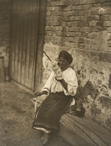 Woman spinning wool