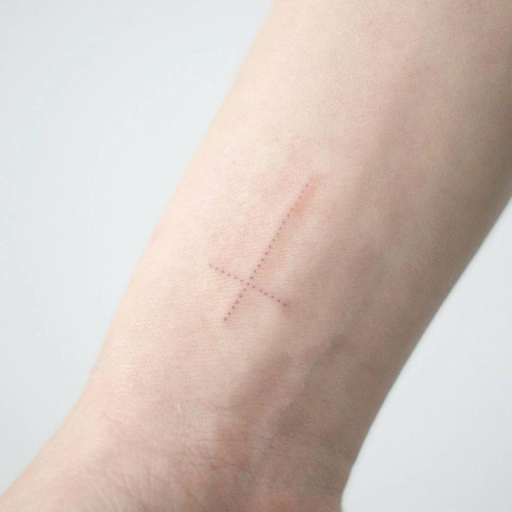 Small dotwork Christian cross tattoo on the right inner wrist. Tattoo artist: Doy – – #smalltattoos – – #smalltattoos