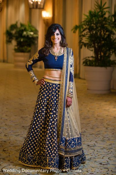 Ink blue full embroidered lehenga and blouse with off white dupatta