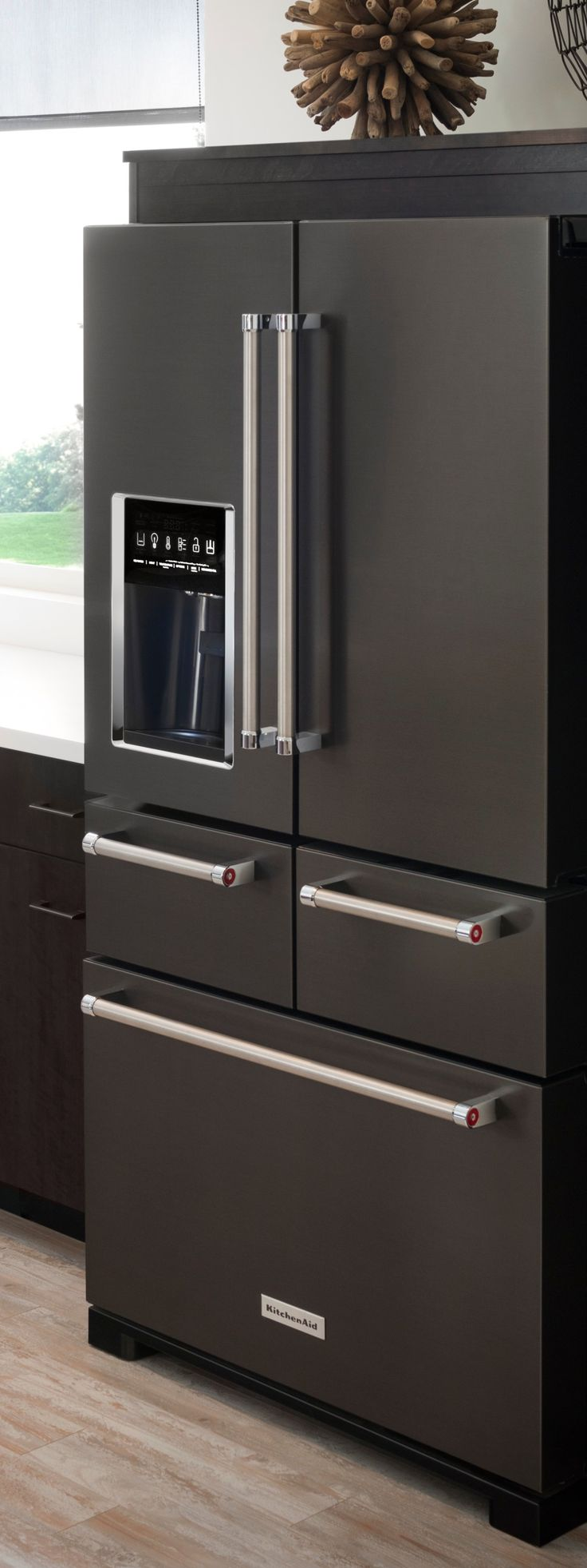Black stainless steel appliances give your kitchen a bold, sleek look. KitchenAid's 5-door refrigerator has the cool factor, plus its configuration offers simplified food storage and access.