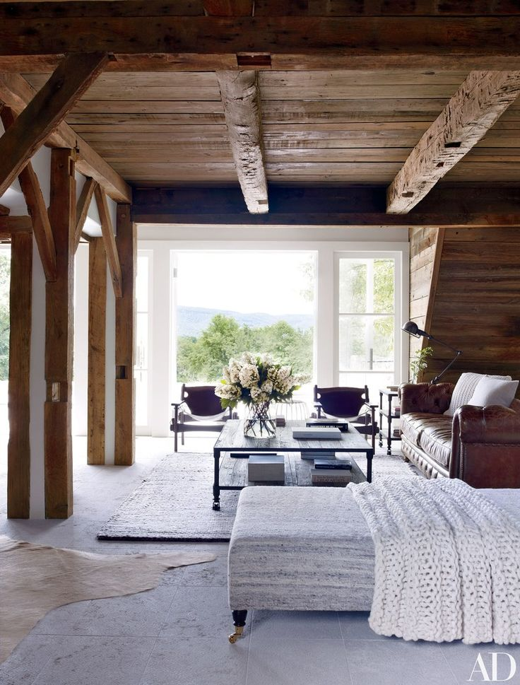 I love that Architectural Digest has begun publishing interiors from their archives online. This stunning New York farmhousebelonging to filmmaker Shawn Levy was originally published in August 2012, but still feels freshtoday. I love the vacation home's rustic exposed beams and modern open floorplan. The well-editedmix of traditional and modern furniture doesn't hurt either. A …