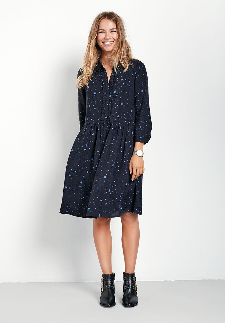 "A pretty shirt dress with delightful ruffle pleats; a wardrobe essential that will take you seamlessly from work to weekend with a simple switch of accessories. •Pleats at collar and placket. •Sits on or above the knee depending on height. •Loose fit. We recommend sizing down if you prefer a closer fit. •Concealed button front closure. •Collared with 3/4 length sleeves. •Model is 5'7"" and wears size 8."